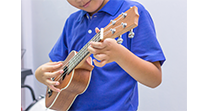 Boy playing guitar Williamsburg Music Lessons